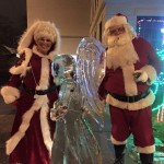 Mrs. & Mr. Claus w/ our angle ice sculpture!